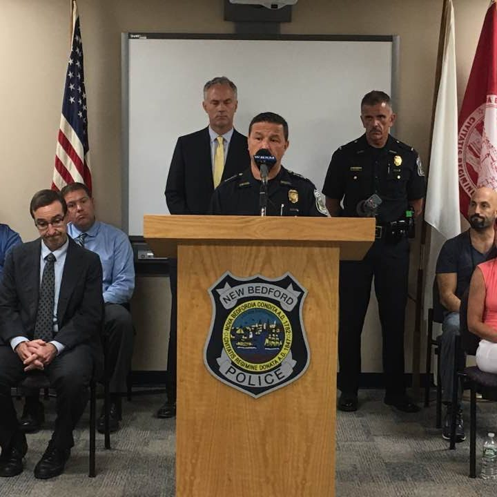 Police Chief Joseph Cordeiro speaks about the drop-in center while Mayor Jon Mitchell, left, and Lt. Amos Melo look on.
