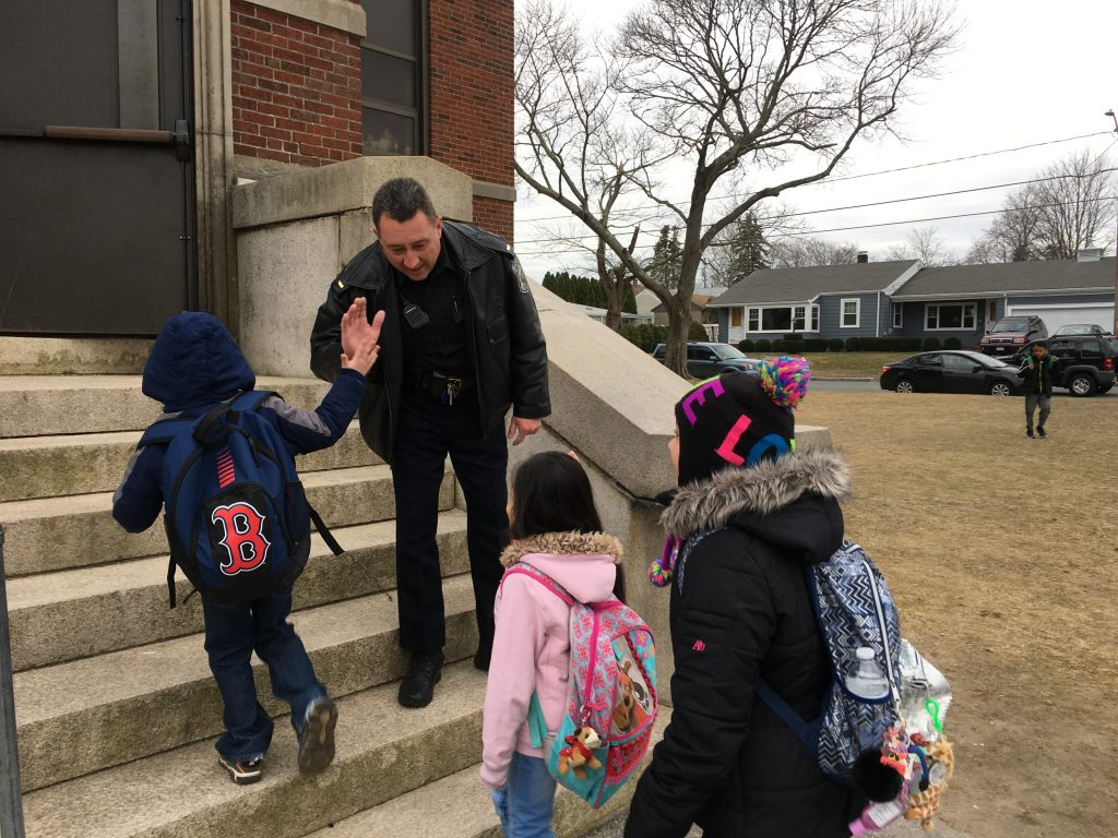 Police greet students at high five friday new bedford police greeting students with high fives as they entered the building and wishing them a great day at school pictured is lt paul demers giving a high five to m4hsunfo